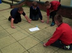 Pupils working together to learn about symmetry