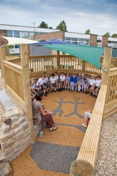A class enjoying a lesson in the new sunken seating area